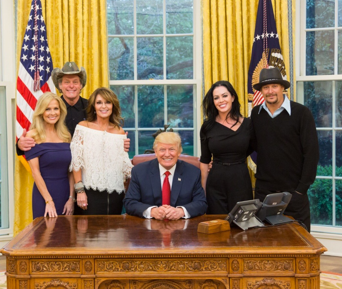 Sarah Palin and President Trump with Ted Nugent and his wife, Shemane Deziel, and Kid Rock and his fiancée, Audrey Berry, at the White House on Wednesday.