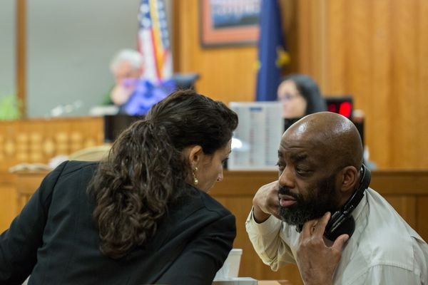 Assistant Public Advocate Kimberly Tsaousis confers with defendent Troy Williams on Wednesday, February 15, 2017, at Nesbett Courthouse. (Ash Adams)