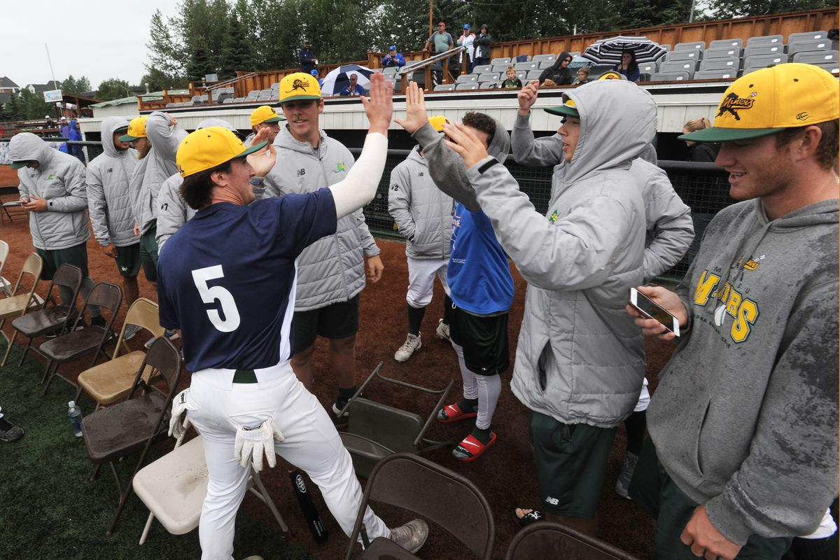Teammates congratulate Mat-Su Miners outfielder Justin Kirby, left, for his win in the Alaska Baseball League's home run derby last summer. (Bill Roth / ADN)