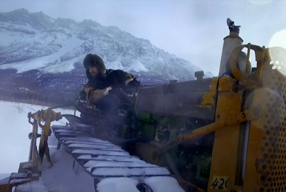 "Jeremy and his new-old bulldozer on ""Edge of Alaska."" (Screen capture via Discovery.com)"