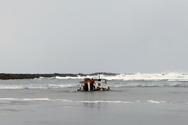 This Tuesday, Jan. 8, 2019 photo provided by the Oregon State Police shows authorities in Newport, Ore., examine the wreckage of the Mary B. II, a commercial crabbing that capsized while crossing Yaquina Bay Bar off the coast of Newport, Ore. Three crew members died in the accident.( Oregon State Police via AP)