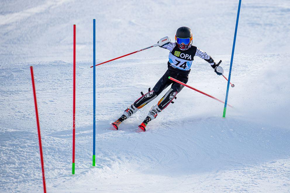 Jaxon Murphy enters a hairpin combination in the boys slalom Saturday at Alyeska. (Photo by Bob Eastaugh)