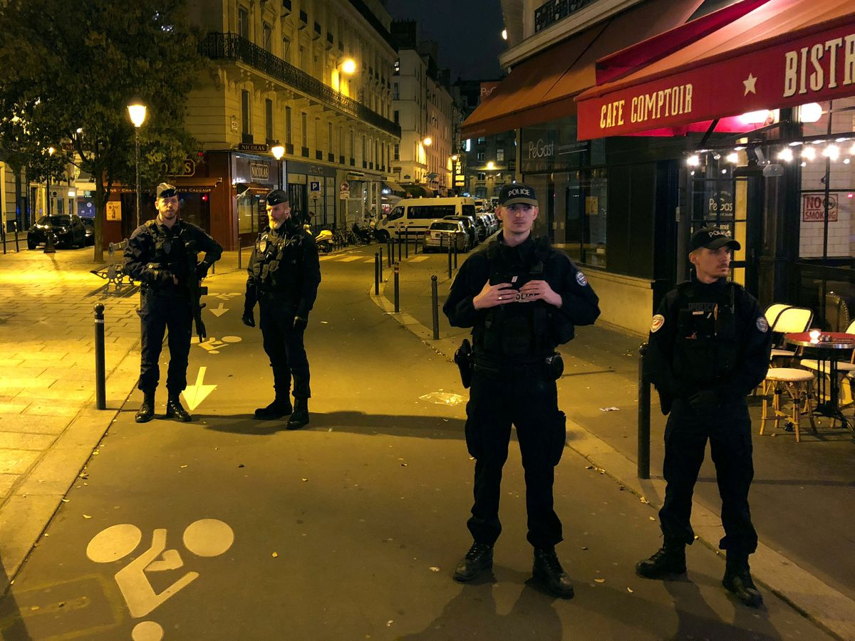 French police secure a street after a man killed a passer-by in a knife attack in the heart of Paris and injured four others before being shot dead by police, according to French authorities in Paris, France, May 12, 2018. REUTERS/Lucien Libert