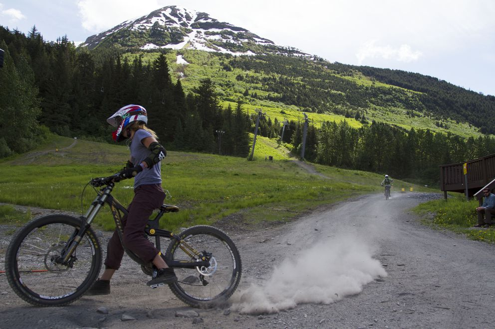 A woman swerves back in line for the lift after going down Chips N Salsa trail at the Alyeska Bike Park on Friday, June 3, 2016. A day pass to the park costs $30. (Sarah Bell / ADN)