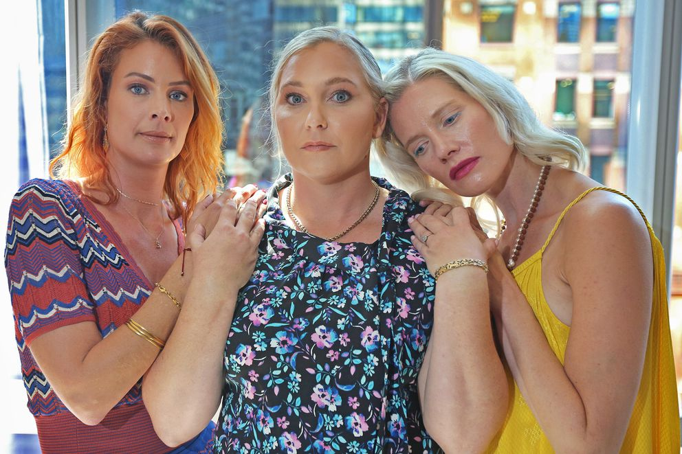 Victims of Jeffrey Epstein, from left, Sarah Ransome, Virginia Roberts Giuffre, and Marijke Chartouni find support in each other after having met at an emotional court hearing for victims of Epstein on August 27, 2019. The three young women had never met before the hearing but said during an interview two days later that the hearing had helped them bond with other women who had suffered similar abuses by Epstein and his co-conspirators. (Emily Michot/Miami Herald/TNS)