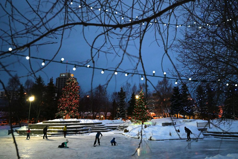 Ice skaters glide across freshly hot mopped ice at Town Square Park on Sunday afternoon, Dec. 27, 2020. (Bill Roth / ADN)