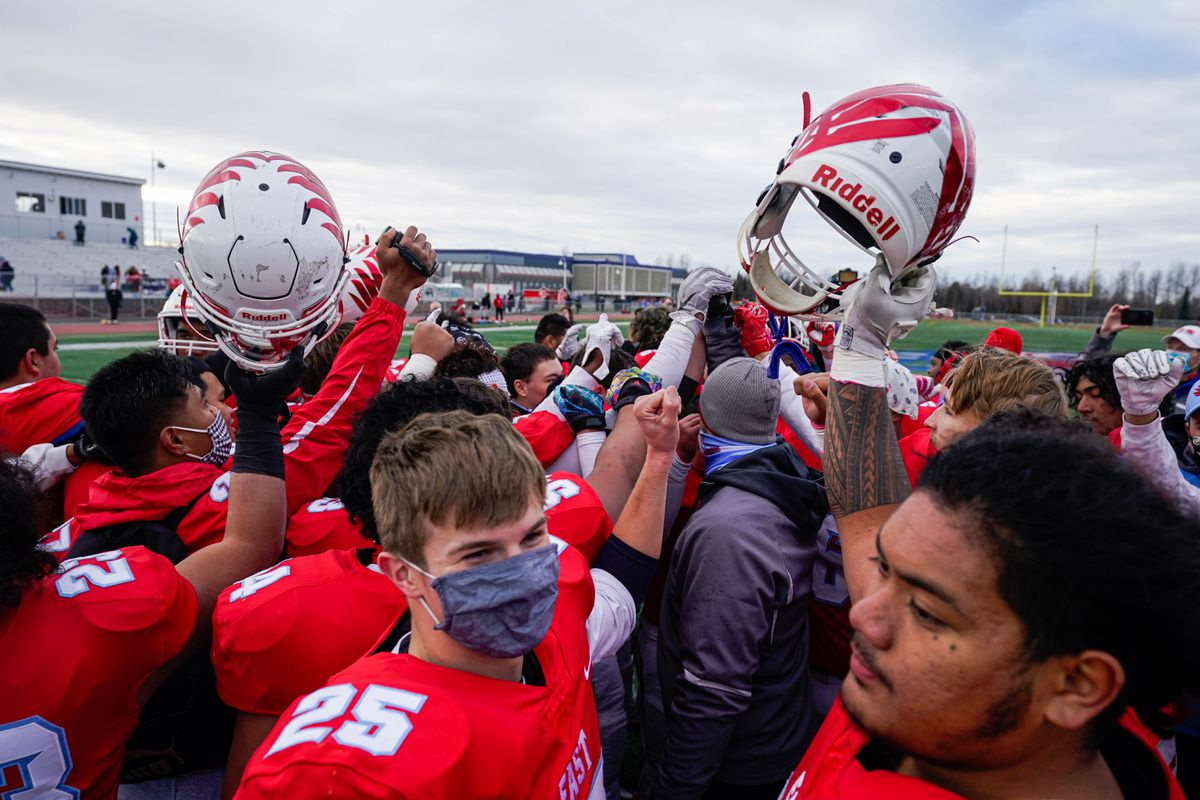 East players celebrate after winning the city championship Saturday by beating Bartlett 41-0. (Loren Holmes / ADN)