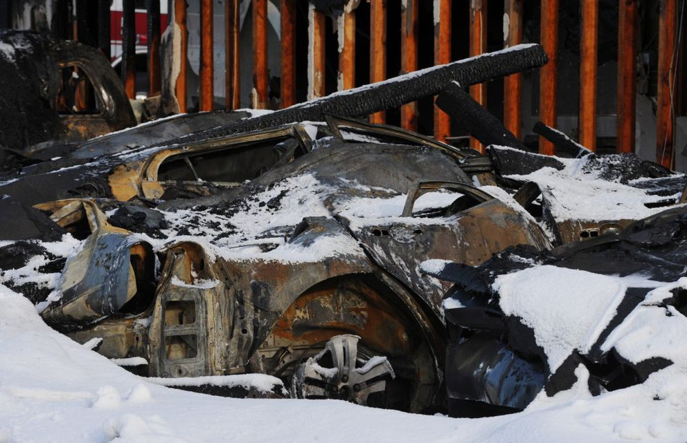 Charred vehicles parked on the west end of the Royal Suite Apartments on Wednesday, Feb. 15, 2017. (Bill Roth / Alaska Dispatch News)