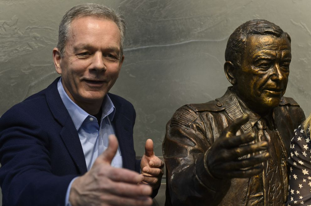 Ben Stevens poses next to a statue of his father, Ted Stevens. (Marc Lester / ADN)