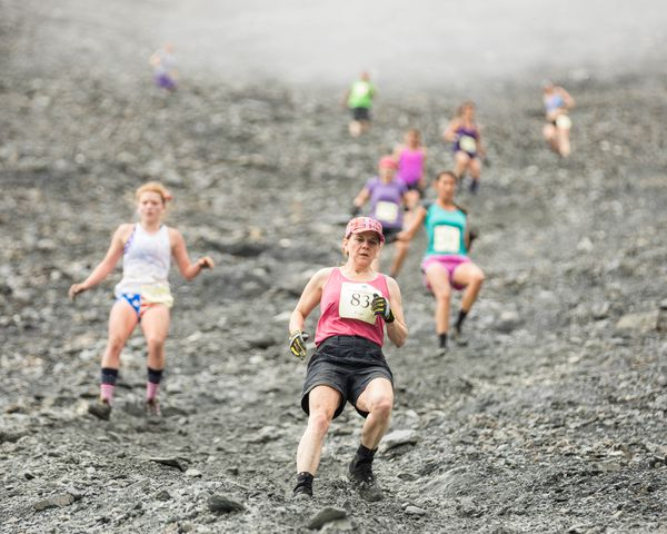 Evie Bear leads a group of competitors in the women's race run down the mountain during the Mount Marathon race Tuesday in Seward. (Loren Holmes / Alaska Dispatch News)