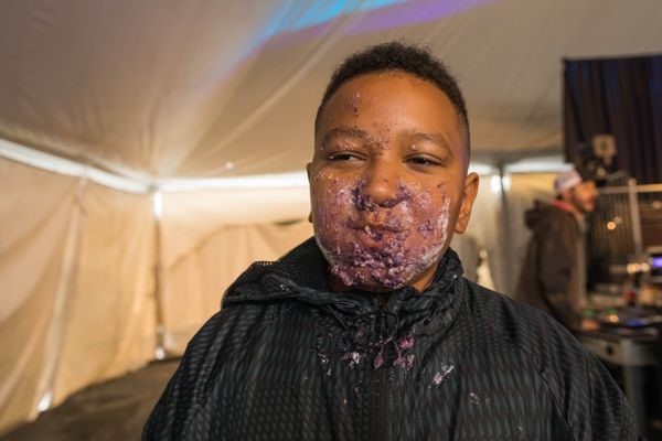 Isaiah Garner, 9, has a face covered in blueberry pie after winning a pie-eating contest Saturday at Alyeska Resort. (Loren Holmes / ADN)