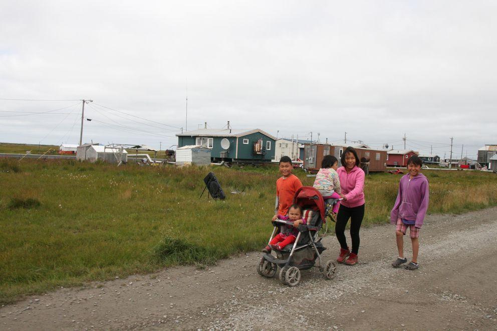 Children take a stroll in the Southwestern Alaska village of Hooper Bay on Aug. 11, 2016. (Lisa Demer / ADN)