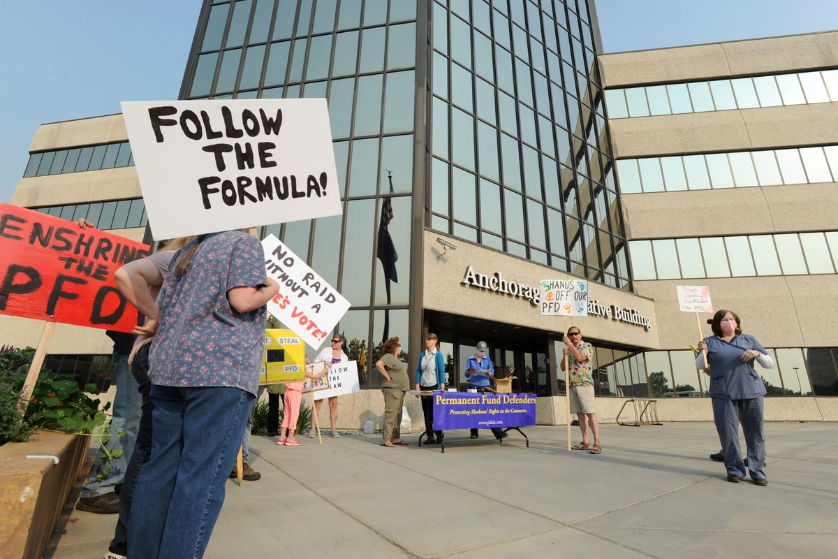 More than a dozen people braved the smoke to rally for the PFD, Friday, June 28, 2019. (Anne Raup / ADN)