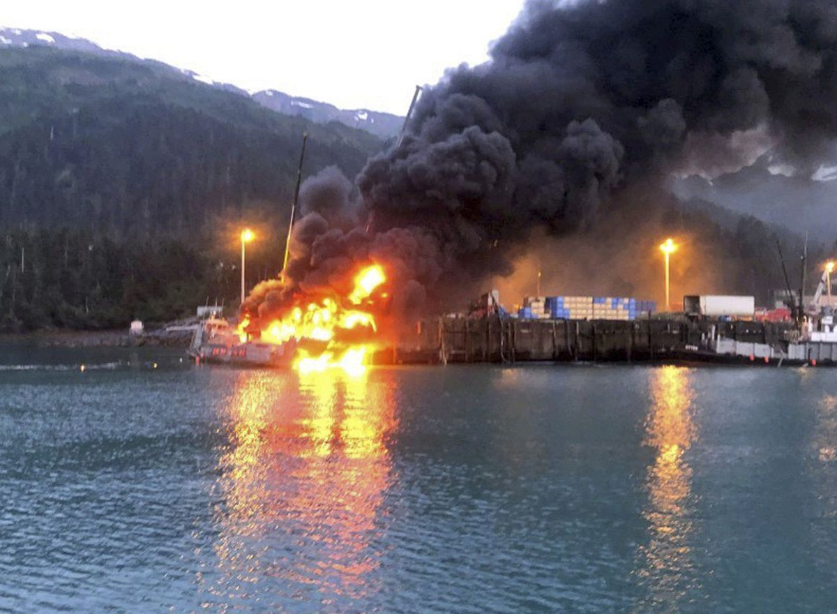 This photo provided by the U.S. Coast Guard shows the fishing boat Alaganik burning at a dock in Whittier, Alaska, in the early morning hours of Monday, July 8, 2019. The Coast Guard says a propane tank exploded around midnight Sunday on the 99-foot fishing vessel at a dock operated by the city of Whittier. The boat burned and sank at the dock. (U.S. Coast Guard via AP)