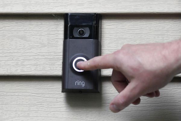 In this Tuesday, July 16, 2019, photo, Ernie Field pushes the doorbell on his Ring doorbell camera at his home in Wolcott, Conn. Police departments around the country are partnering with the doorbell camera company Ring in an effort to fight crime and create a sort of modern-day neighborhood watch. (AP Photo/Jessica Hill)