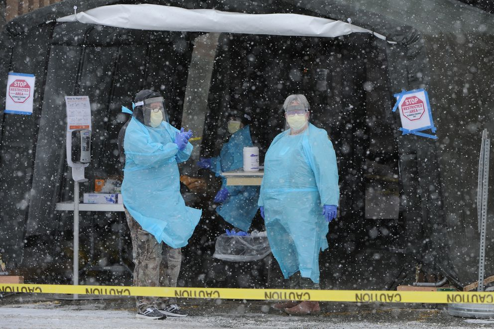 Healthcare providers took nasal swabs from people at a drive-thru testing site off Lake Otis on Tuesday, March 17, 2020, that will be tested for COVID-19. (Bill Roth / ADN)
