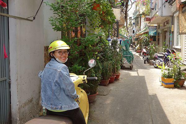 Huong pauses during a tour around Saigon. (Photo: Scott McMurren)