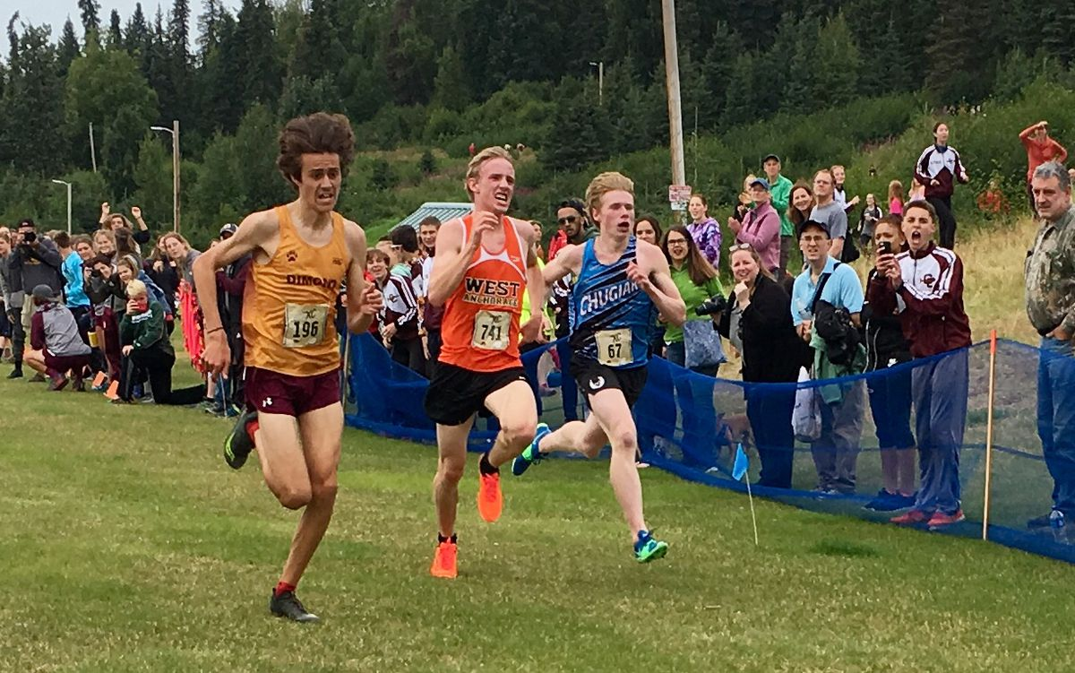 Santiago Prosser, left, wins a three-way battle for first place Saturday in the Tsalteshi Invitational cross-country meet in Soldotna on Saturday, Aug, 18, 2018. Everett Cason of West, center, placed second, and Daniel Bausch of Chugiak was third. (Photo by Steve Judd)