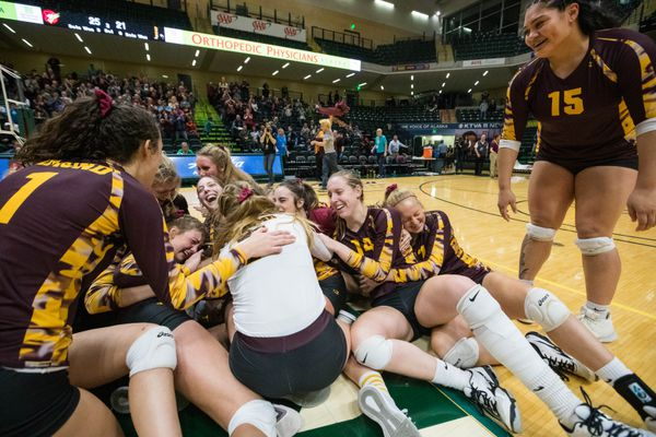 The Dimond Lynx celebrate winning the ASAA 4A state volleyball championship Saturday, Nov. 10, 2018 at the Alaska Airlines Center. Dimond beat West in the final. (Loren Holmes / ADN)