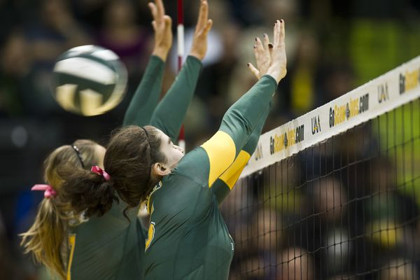 The ball gets by UAA's Leah Swiss and Erin Braun at the net. UAA faced Western Washington in volleyball at the Alaska Airlines Center in Anchorage on Saturday. (Marc Lester / Alaska Dispatch News)