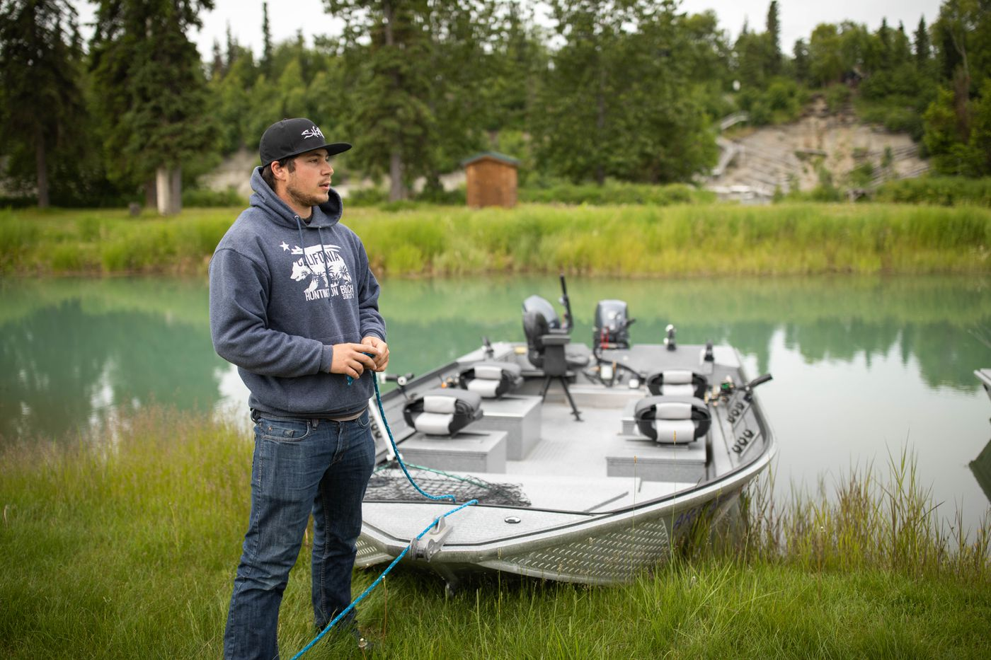 Chad Porterfield, a fishing guide at RW's Fishing and Big Eddy Resort on the outskirts of Soldotna, ties up a boat at the resort on Friday, June 29, 2018. Fishing for king salmon is a top draw for most anglers visiting the Kenai River, and this summer's closures are leaving guides scrambling to offer their guests alternatives. (Loren Holmes / ADN)