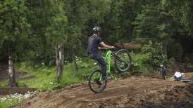 Construction at Anchorage's Hilltop bike park is in high gear ahead of August opening