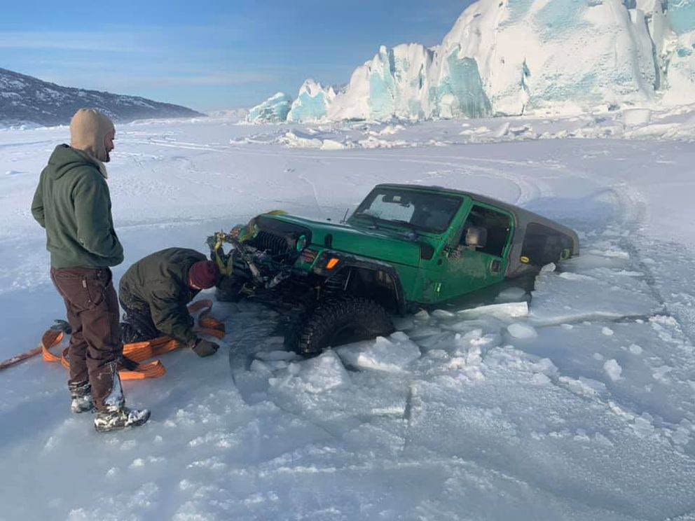 Scott Rees hooks a tow rope to Josh Tills' Jeep after it sank near Knik Glacier on Jan. 26, 2020. (Photo provided by Scott Rees)