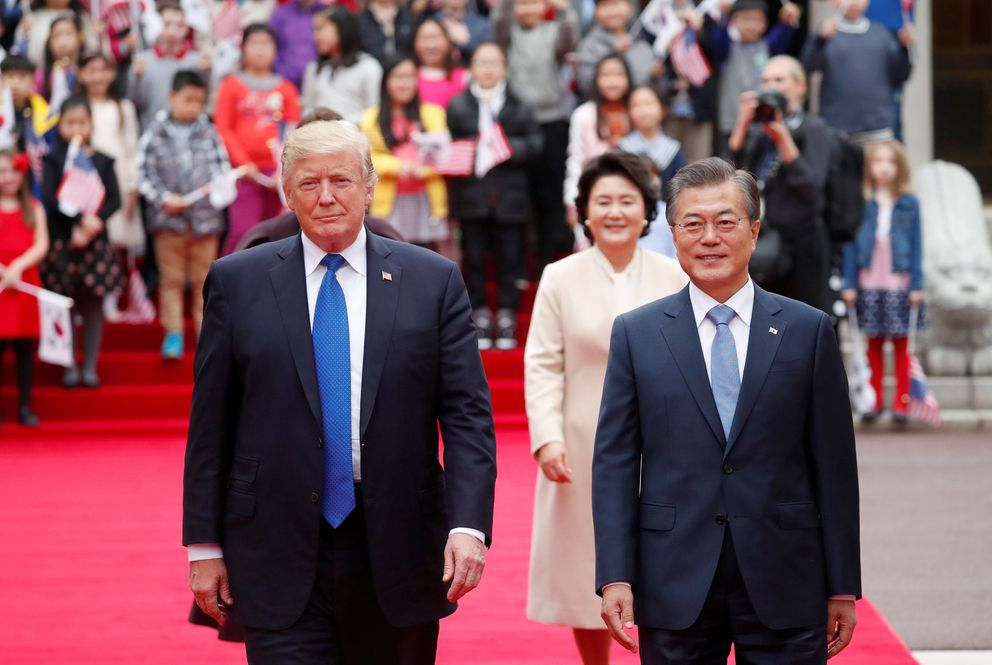 President Donald Trump walks with South Korea's President Moon Jae-in during a welcoming ceremony Tuesday at the Presidential Blue House in Seoul. REUTERS/Kim Hong-Ji