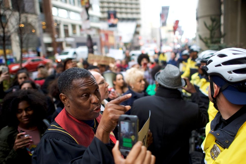 Rev. Gregory Holston, 56, and other interfaith clergy leaders march Monday from the Center City Starbucks, where two black men were arrested, to other nearby stores in Philadelphia. REUTERS/ Mark Makela