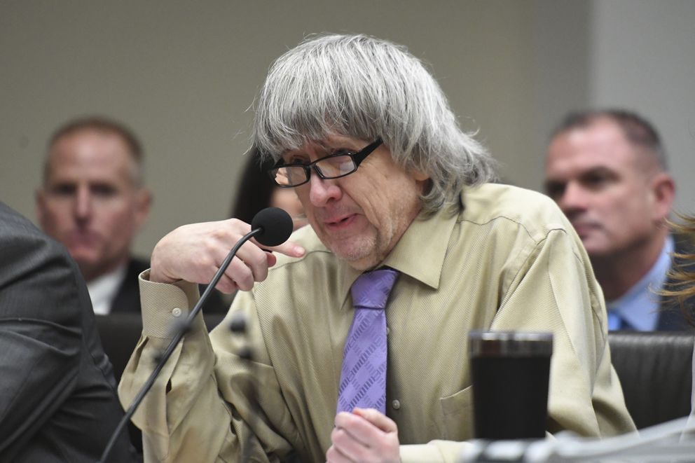 David Turpin becomes emotional as he reads a statement during a sentencing hearing Friday, April 19, 2019, in Riverside, Calif. Turpin and his wife, Louise, who pleaded guilty to years of torture and abuse of 12 of their 13 children have been sentenced to life in prison with possibility of parole after 25 years. (Will Lester/The Orange County Register via AP, Pool)