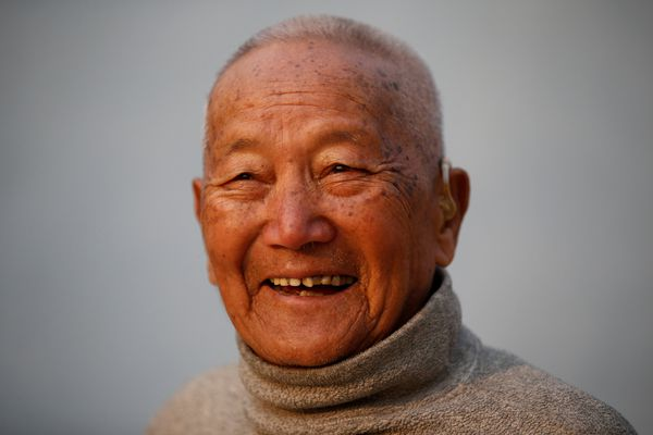 FILE PHOTO: Nepali mountain climber Min Bahadur Sherchan, 85, who will attempt to climb Everest to become the oldest person to conquer the world's highest mountain, smiles as he performs yoga in Kathmandu, Nepal April 12, 2017. REUTERS/Navesh Chitrakar/File Photo
