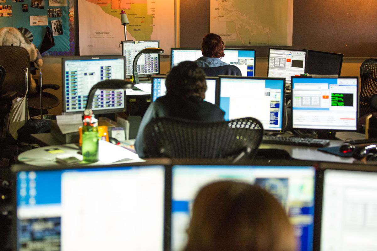 Police dispatchers answer 911 calls at the Anchorage Police Department's emergency communications center in June 2015.(Loren Holmes / Alaska Dispatch News)