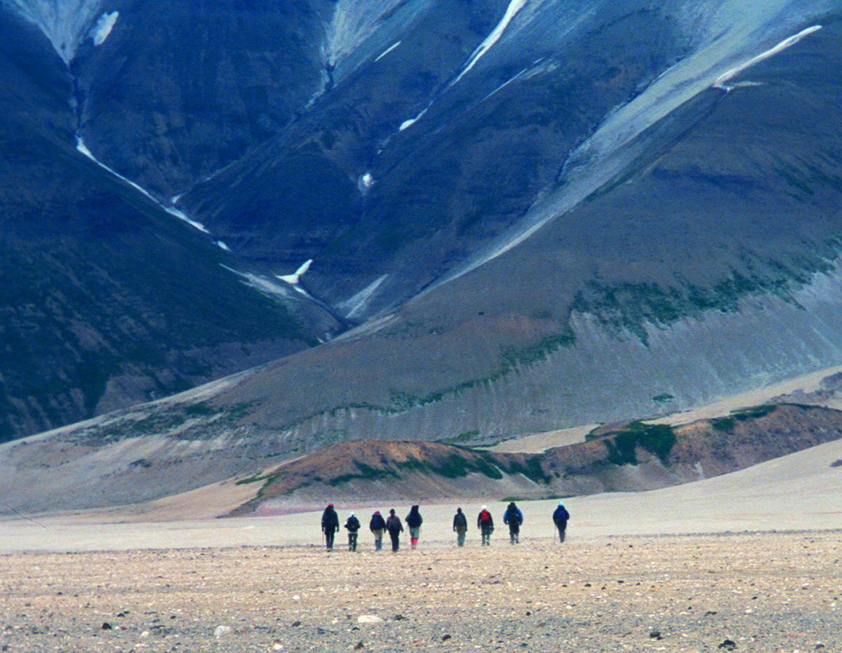 Hikers traverse the Valley of Ten Thousand Smokes on the Alaska Peninsula, walking on a sheet of ash and volcanic rock more than 500 feet thick. (Photo by Ned Rozell)