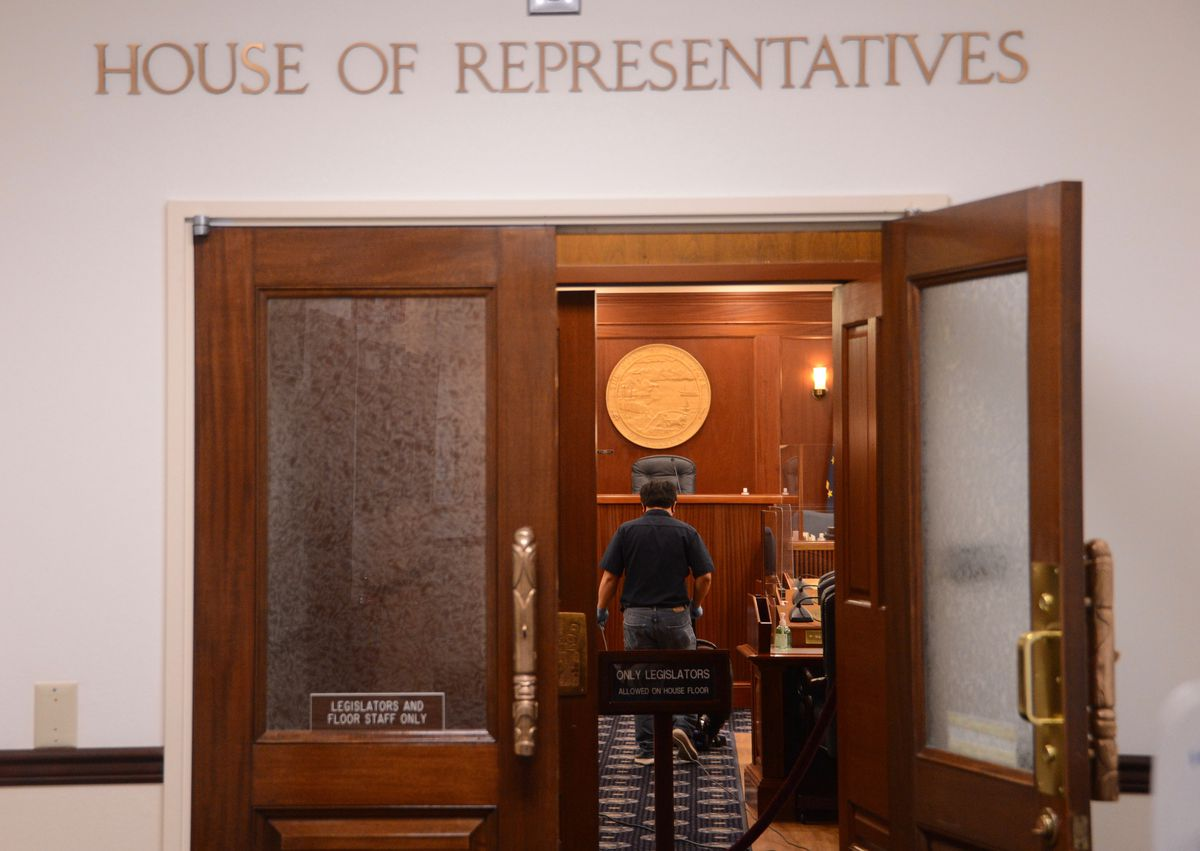 The chambers of the Alaska House of Representatives are seen empty on Thursday, Jan. 28, 2021 except for janitorial staff as Gov. Mike Dunleavy delivers the annual State of the State address from Anchorage. (James Brooks / ADN)