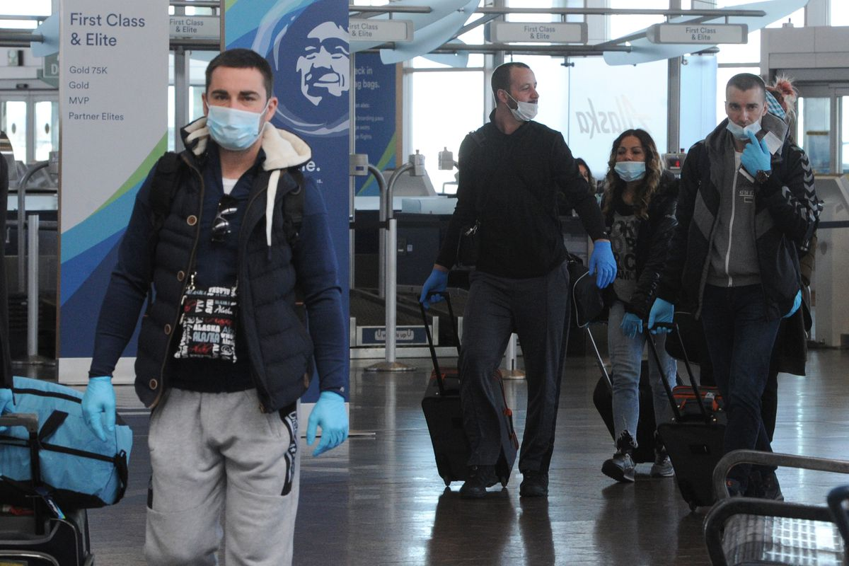 Air travelers at Ted Stevens Anchorage International Airport on Sunday, May 3, 2020, during the COVID-19 pandemic. (Bill Roth / ADN)
