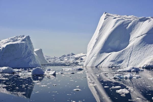 These icebergs are calved by the Jakobshavn glacier, and may stay in the icefjord for years, before floating North with the currents, eventually turning south and down into the Atlantic ocean. They usually range in height from 1 to 75 meters. The air in the glacial ice of an iceberg is under great pressure, and crackles and pops as it melts giving rise to the term Bergie Seltzer. (Thinkstock)
