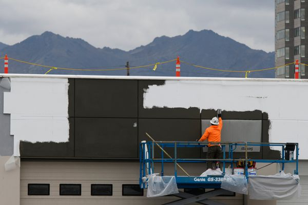Randy Scott, of J&V Drywall and Plaster works on the exterior of the Midtown Mall on October 2, 2018. (Marc Lester / ADN)
