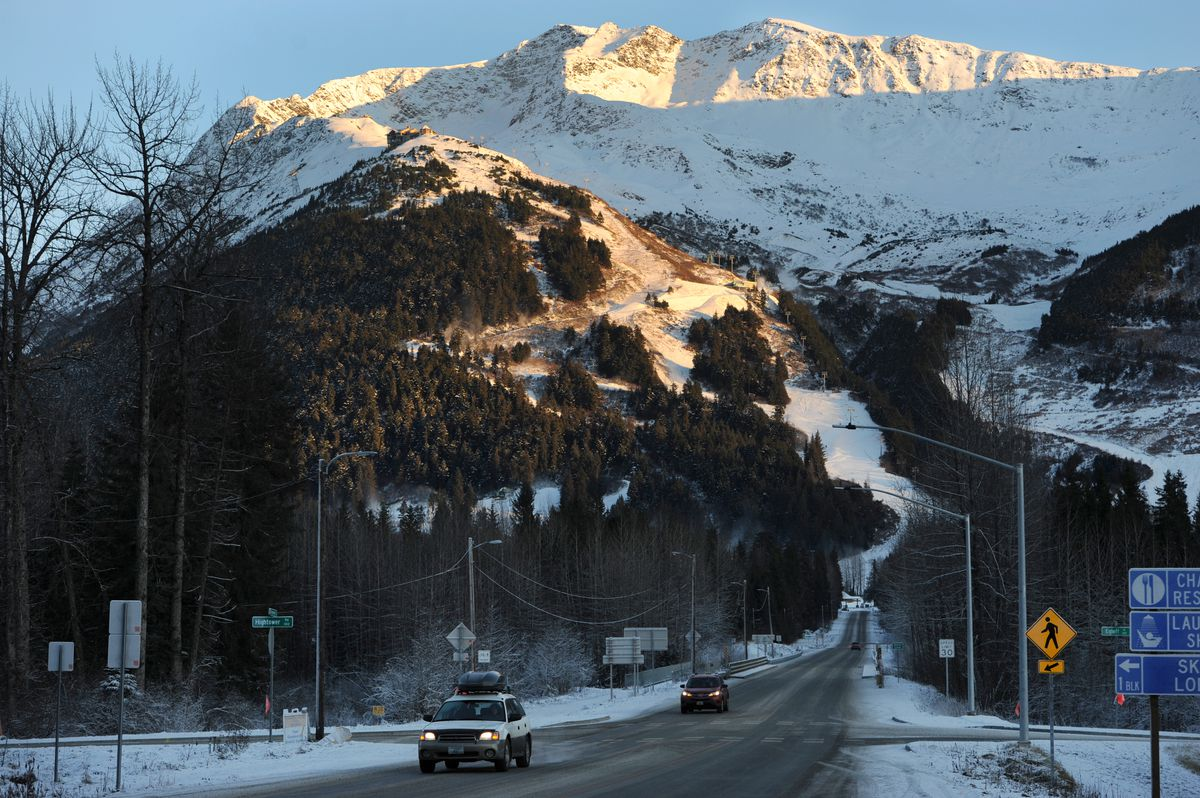 Sunlight illuminates ski and snowboard trails at Alyeska Resort. (Bill Roth / ADN)