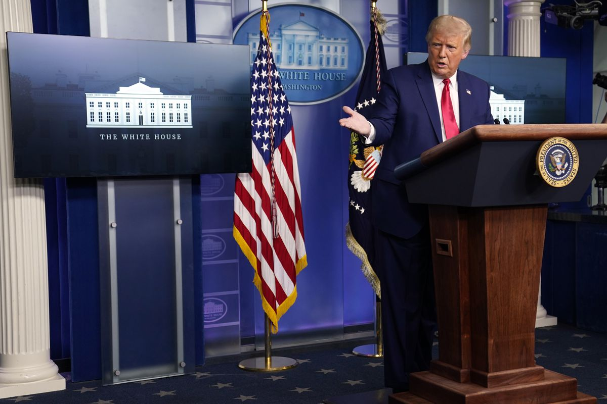 President Donald Trump gestures to White House coronavirus adviser Dr. Scott Atlas during a news conference at the White House, Wednesday, Sept. 16, 2020, in Washington. (AP Photo/Evan Vucci)