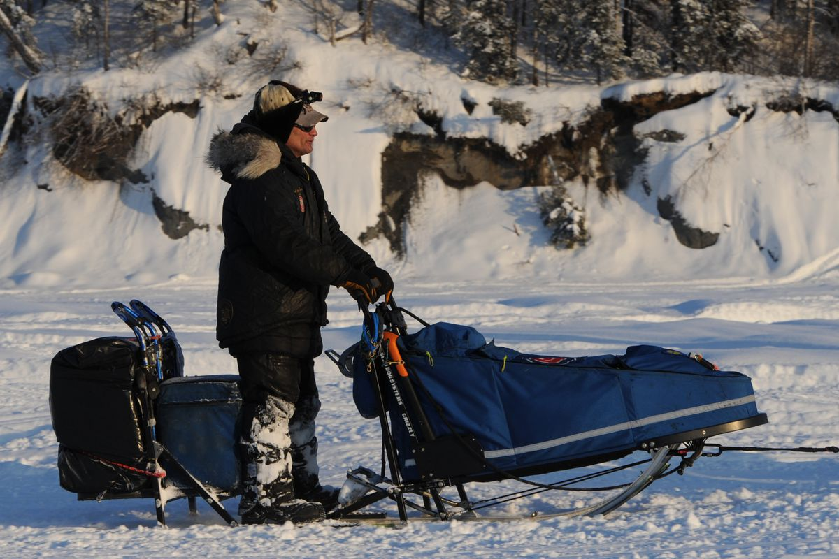 Hugh Neff drives his dog team down the Susitna River during the Restart of the Iditarod Trail Sled Dog Race in Willow on Sunday, March 4, 2018. (Bill Roth / ADN)