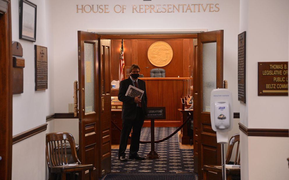 Representative-elect James Kaufman, R-Anchorage, stands in the doorway of the Alaska House of Representatives on Wednesday, Jan. 13, 2021 before a mock floor session intended to teach new legislators rules of procedure. (James Brooks / ADN)
