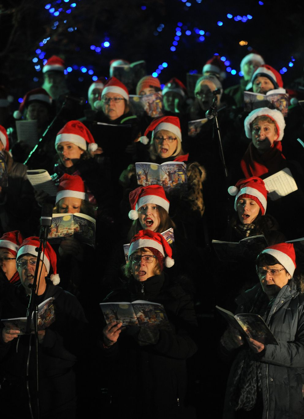The Anchorage Concert Chorus sings before Santa Claus arrived at Town Square Park on his sleigh pulled by his reindeer to light the tree in Town Square Park in downtown Anchorage, Alaska, on Friday, November 25, 2016. The Holiday Tree Lighting Ceremony also featured singers, dancers. (Bob Hallinen / Alaska Dispatch News)