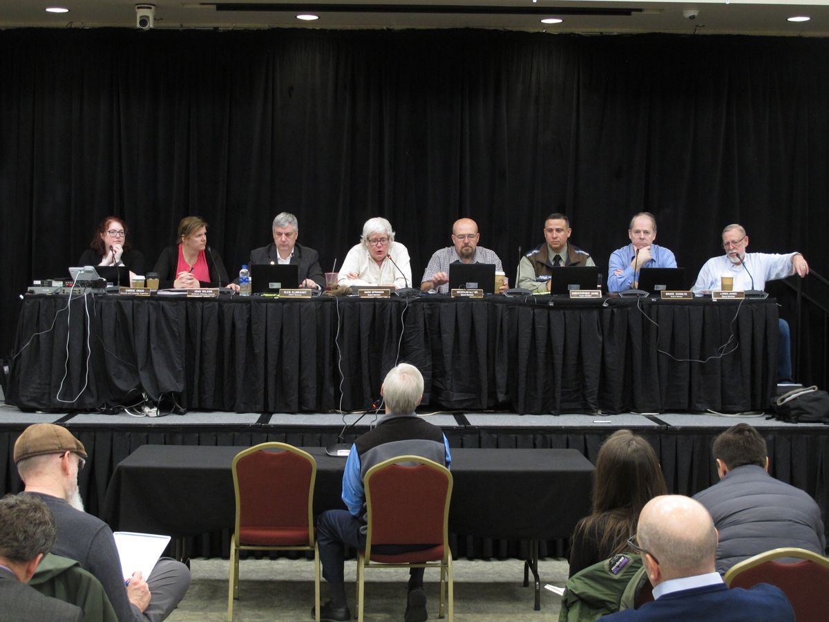 The Alaska Marijuana Control Board listens to testimony during a public comment period on Thursday, Jan. 23, 2020, in Juneau, Alaska. Alaska's legal marijuana industry hit a milestone Thursday, as regulators approved the first retail stores that will be allowed to have customers consume marijuana products on site. (AP Photo/Becky Bohrer)