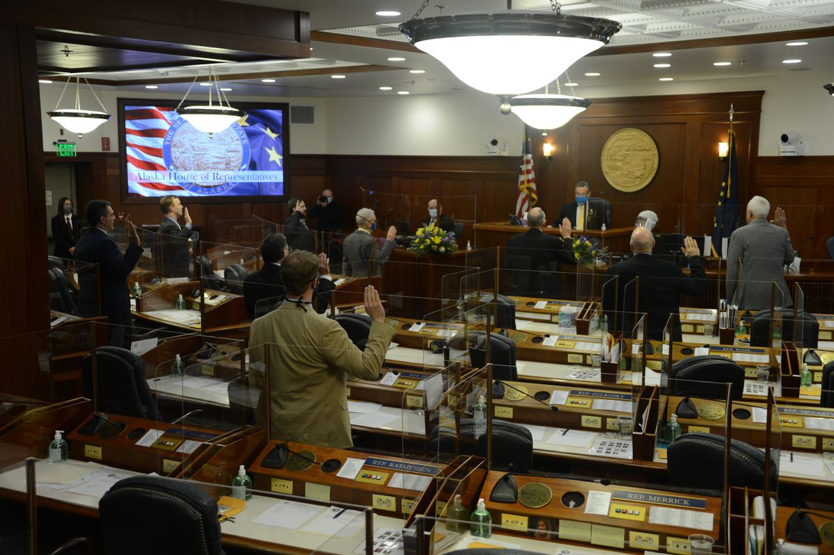 Members of the Alaska House of Representatives take their oaths of office on Tuesday, Jan. 19, 2021 in the Alaska State Capitol at Juneau, Alaska. Members of the 40-person House took their oaths in four 10-person groups. (James Brooks / ADN)