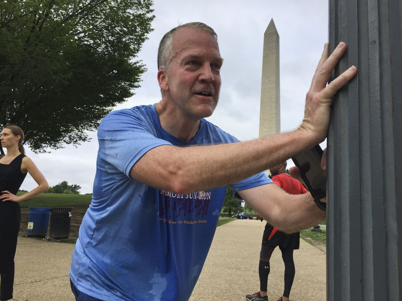 Sen. Dan Sullivan stretches as he waits for a traffic light to change while on morning run in Washington, D.C., on June 19, 2019. (Marc Lester / ADN)
