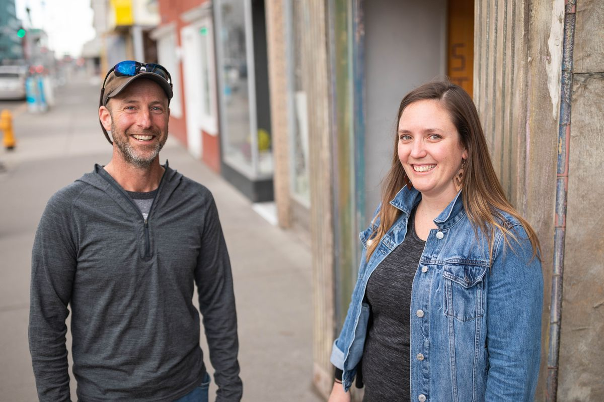 Matt Rafferty and Emily Fehrenbacher, two former Arctic Entries volunteers, pose for a photo in downtown Anchorage on Friday, April 13, 2018. (Loren Holmes / ADN)