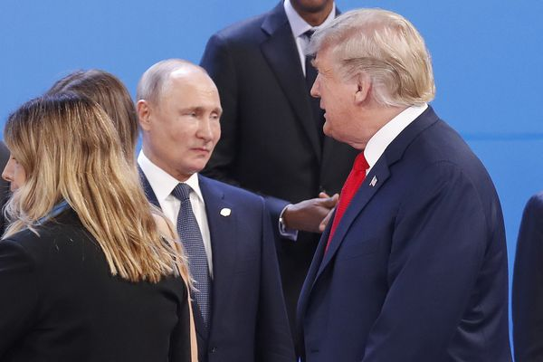 FILE - In this Nov. 30, 2018, file photo, President Donald Trump, right, walk past Russia's President Vladimir Putin, left, as they gather for the group photo at the start of the G20 summit in Buenos Aires, Argentina. (AP Photo/Pablo Martinez Monsivais, File)