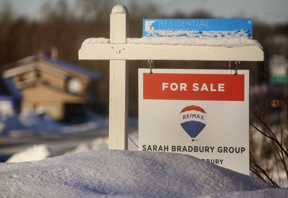A 'For Sale ' sign is posted on the corner of Jarvis Avenue and Old Seward Highway in South Anchorage on Monday, Feb. 1, 2021. (Emily Mesner / ADN)