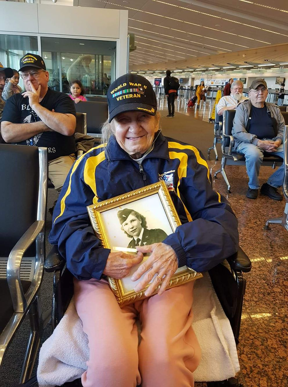 Eagle River's Charlotte Schwid poses for a photo while attending an Honor Flight homecoming event in May 2019. (Photo by Sharon White / Courtesy)