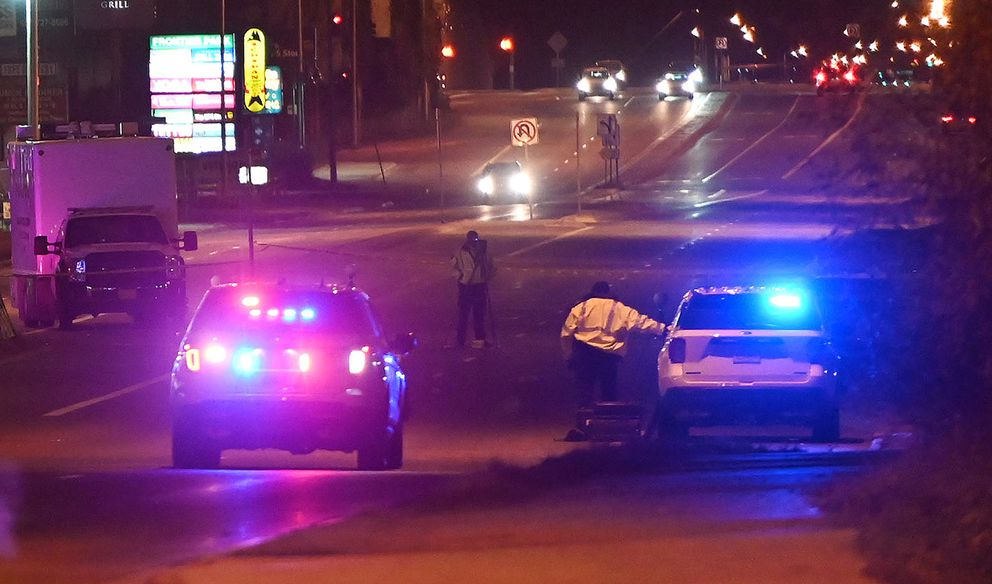 Anchorage Police investigate the scene of a fatal vehicle / pedestrian collision on East Tudor Road near Wright Street that occurred Saturday evening, Oct. 24, 2020. (Bill Roth / ADN)